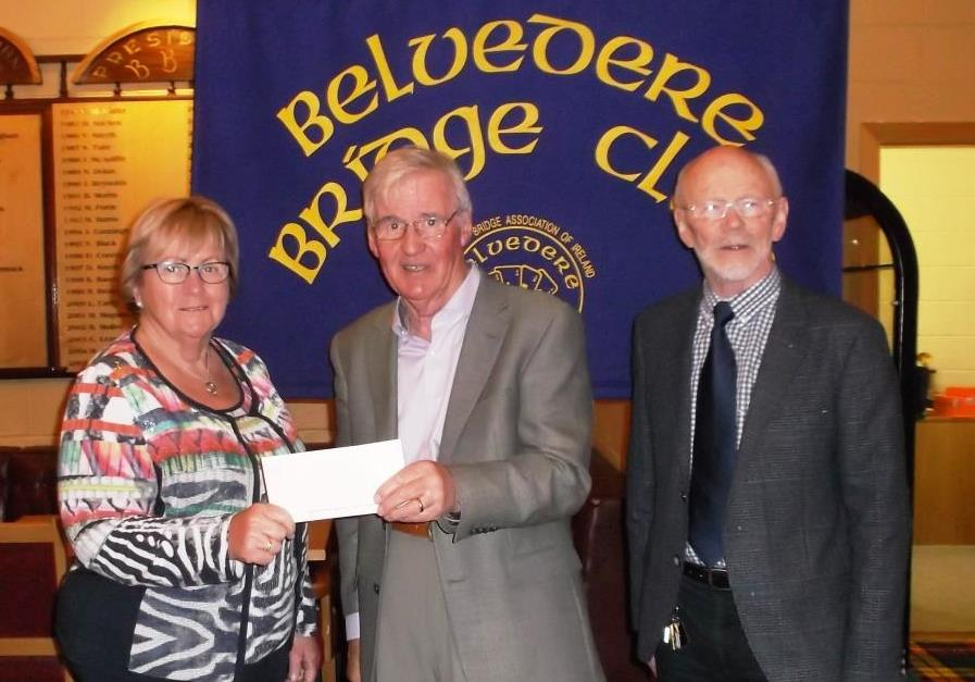 Deirdre from Midland Samaritans receives a cheque from Frank Maher, President Belvedere Bridge Clubith on Right Kieron, Midland Samaritans