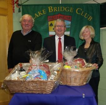 Lake Bridge Club Christmas Hamper - 3rd Nett winners Jim Quinlavin and Kay Moore with Gerry O'Gorman, Club President