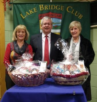 OLake Bridge Club Christmas Hamper - 4th Gross winners Brid Galligan and Monica Harris with Gerry O'Gorman, Club President