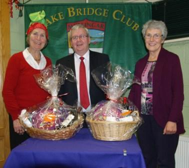 Lake Bridge Club Christmas Hamper - 7th Nett winners Susan Brown and Mary Savage with Gerry O'Gorman, Club President