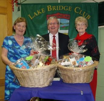 Lake Bridge Club Christmas Hamper Gross winners Susan Tuite and Helen Lynch with Gerry O'Gorman Club President