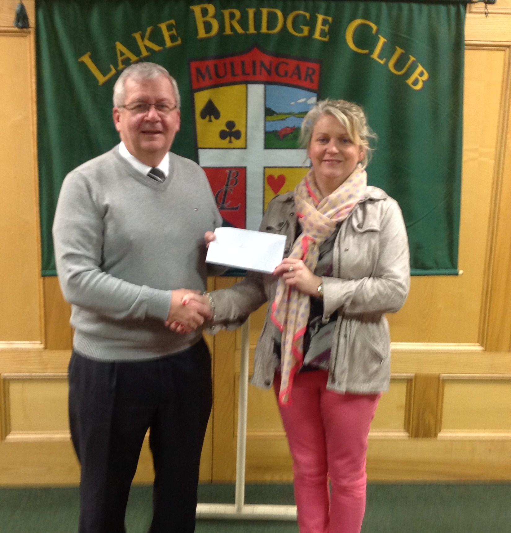 Lake Club President Gerry O'Gorman presenting a cheque to Bernie McHugh from LARCC.