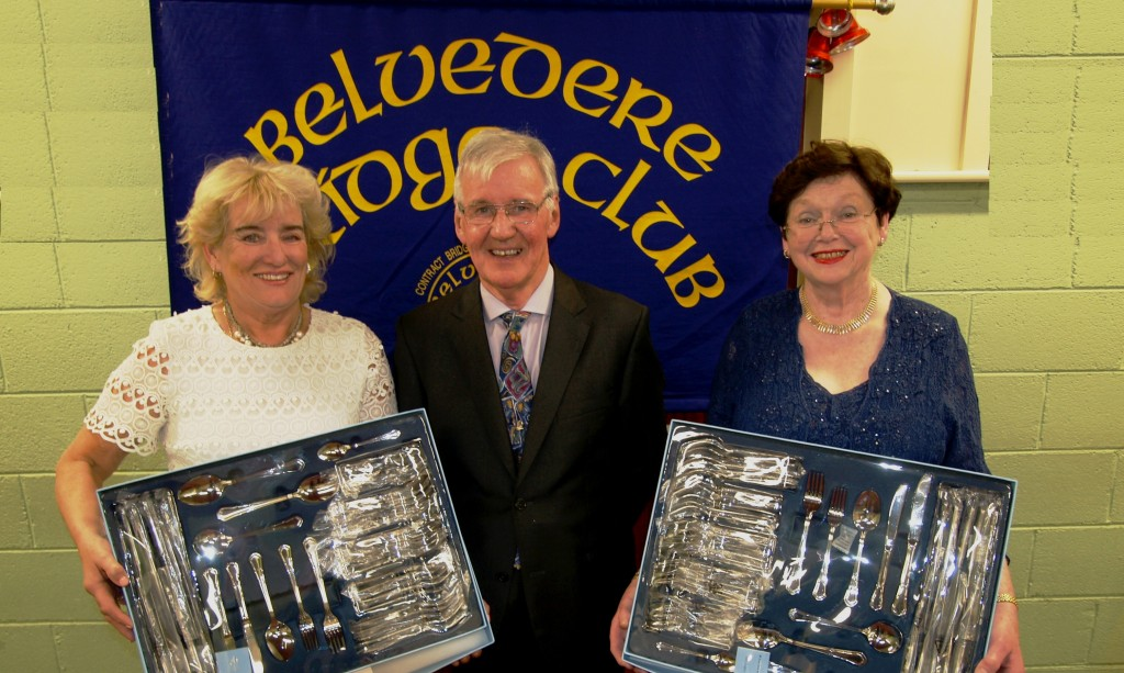 Belvedere Club President Frank Maher, presents his prize to the winners Mary McCormack and Eileen Corrigan.