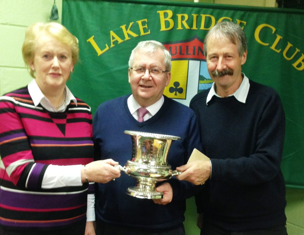 Winners of Analagh Trophy Carmel Maher and Sean Galligan with Gerry O Gorman, Lake  Club president.